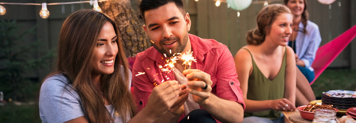 Woman and man with firecracker
