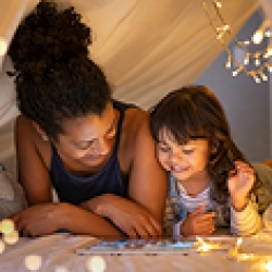 picture of a mom and daughter reading