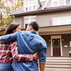picture of a man and woman in front of a home