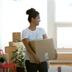 Picture of a woman carrying a box