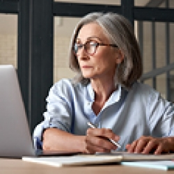 picture of a woman looking at a computer