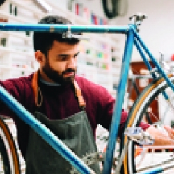 picture of a man working on a bike