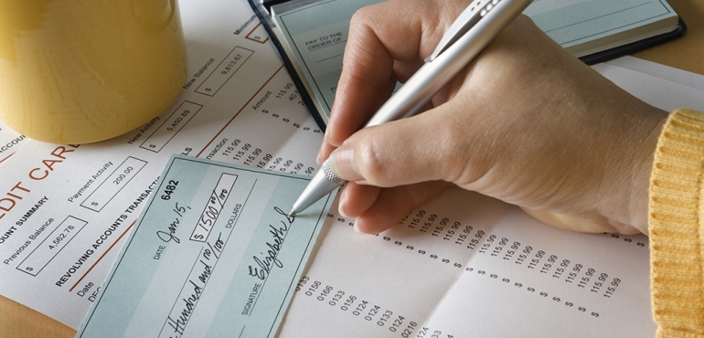 picture of someone writing a check